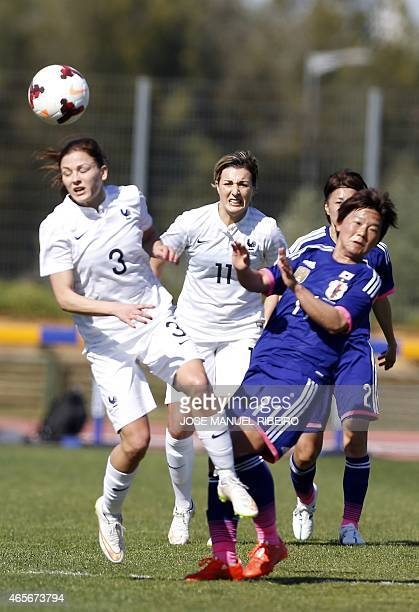 France's defender Laura Boulleau heads a ball beside midfielder Claire Lavogez and Japan's forward Shinobu Ohnoduring the Algarve Cup football match...