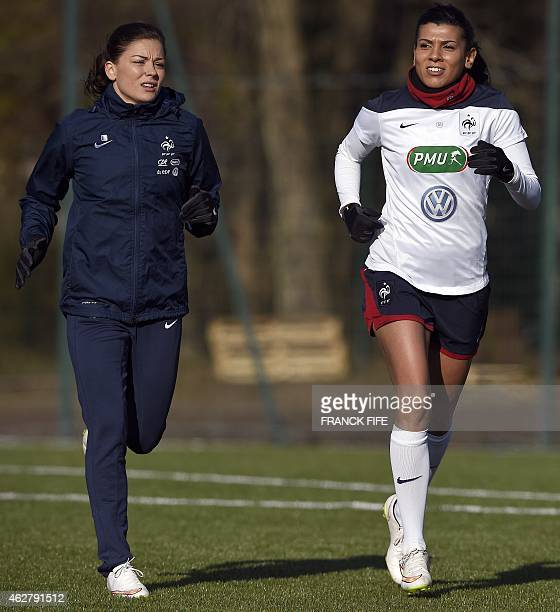 France's defender Laure Boulleau and midfielder Kenza Dali run during a training session in Clairefontaine en Yvelines on February 5 2015 ahead of...