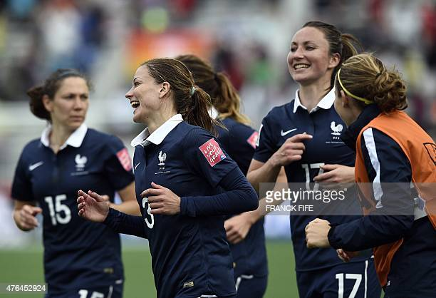France's defender Laure Boulleau and teammates react at the end of Group F match at the 2015 FIFA Women's World Cup between France and England at...