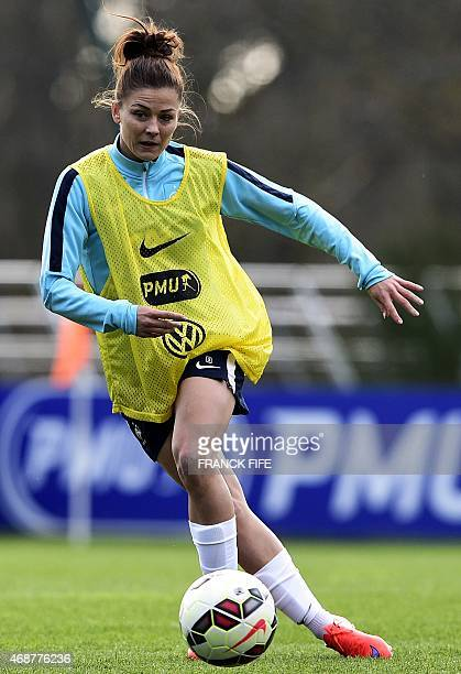 France's defender Laure Boulleau controls the ball during a training session in ClairefontaineenYvelines southwest of Paris on April 6 ahead of the...