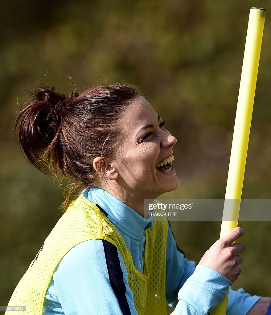 France's defender <a gi-track='captionPersonalityLinkClicked' href=/galleries/search?phrase=Laure+Boulleau&family=editorial&specificpeople=7890874 ng-click='$event.stopPropagation()'>Laure Boulleau</a> smiles during a training session in Clairefontaine en Yvelines, southwest of Paris, on April 6 , 2015, ahead of the friendly football match against Canada to be held on April 9.