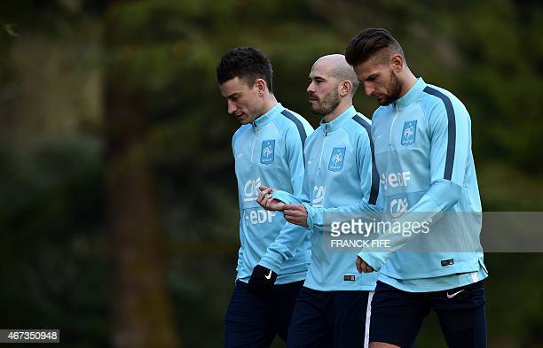 France's defender Laurent Koscielny defender Christophe Jallet and goalkeeper Benoit Costil arrive for a training session in Clairefontaine on March...