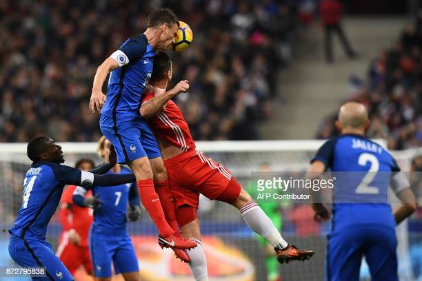 France's defender Laurent Koscielny heads the ball during the friendly football match between France and Wales at the Stade de France stadium in...