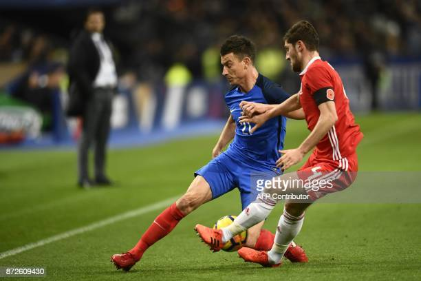 France's defender Laurent Koscielny vies for the ball with Wales' defender Ben Davies during the friendly football match between France and Wales at...