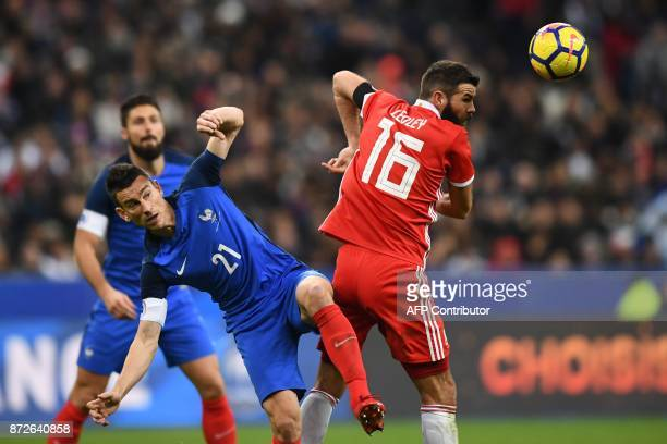 France's defender Laurent Koscielny vies for the ball with Wales' midfielder Joe Ledley during the friendly football match between France and Wales...