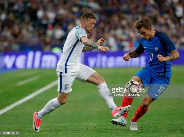 France's defender Lucas Digne and England's defender Kieran Trippier fight for the ball during the international friendly football match between...