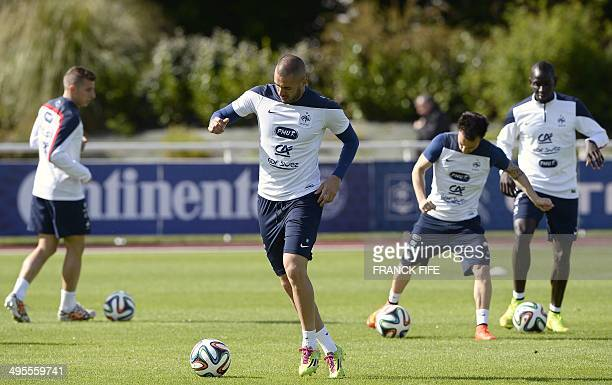 France's defender Lucas Digne forward Karim Benzema midfielder Mathieu Valbuena and defender Mamadou Sakho attend a training session in...