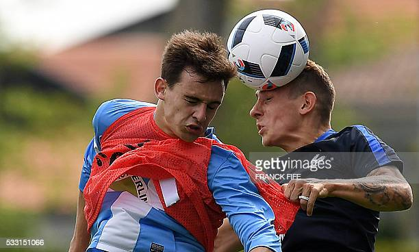 France's defender Lucas Digne heads the ball during the friendly match between French national football team and Bayonne at the Aguilera stadium in...