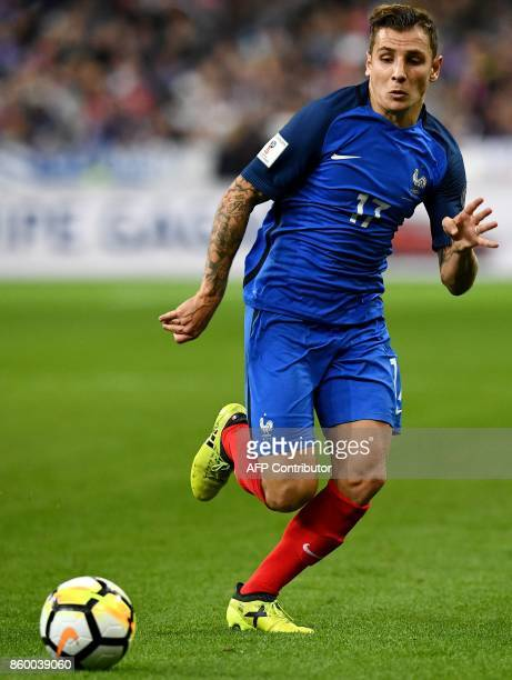 France's defender Lucas Digne runs after the ball during the FIFA World Cup 2018 qualification football match between France and Belarus at the Stade...