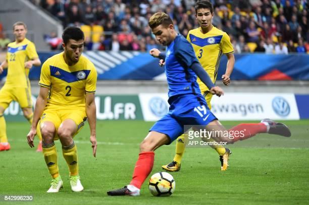 France's defender Lucas Hernandez kicks the ball to score despite the opposition of Kazakhstan's defender Dauren Mazhitov during the U21 Euro 2017...