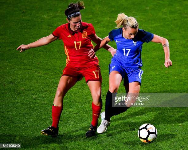 France's defender Marion Torrent outruns Spain's forward Mariona Caldentey during a friendly football match between France and Spain on September 18...