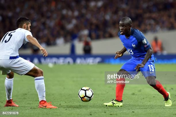 France's defender N'Golo Kante fights for the ball with Luxembourg's defender Aldin Skenderovic during the FIFA World Cup 2018 qualifying football...