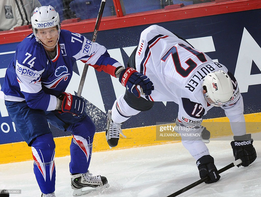 France's defender Nicolas Besch sends US forward Bobby Butler down on ice during a preliminary round game USA vs France of the IIHF International Ice...
