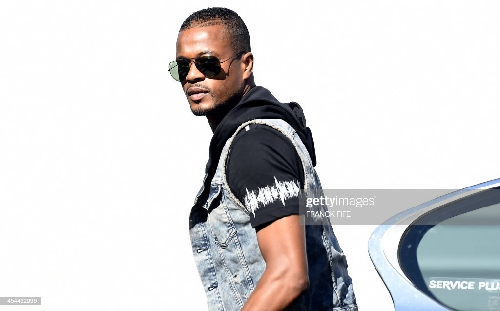 France's defender Patrice Evra arrives at the French national football team training base in Clairefontaine on September 1, 2014 on the first day of their training ahead of the friendly football match against Spain to be held on September 4.