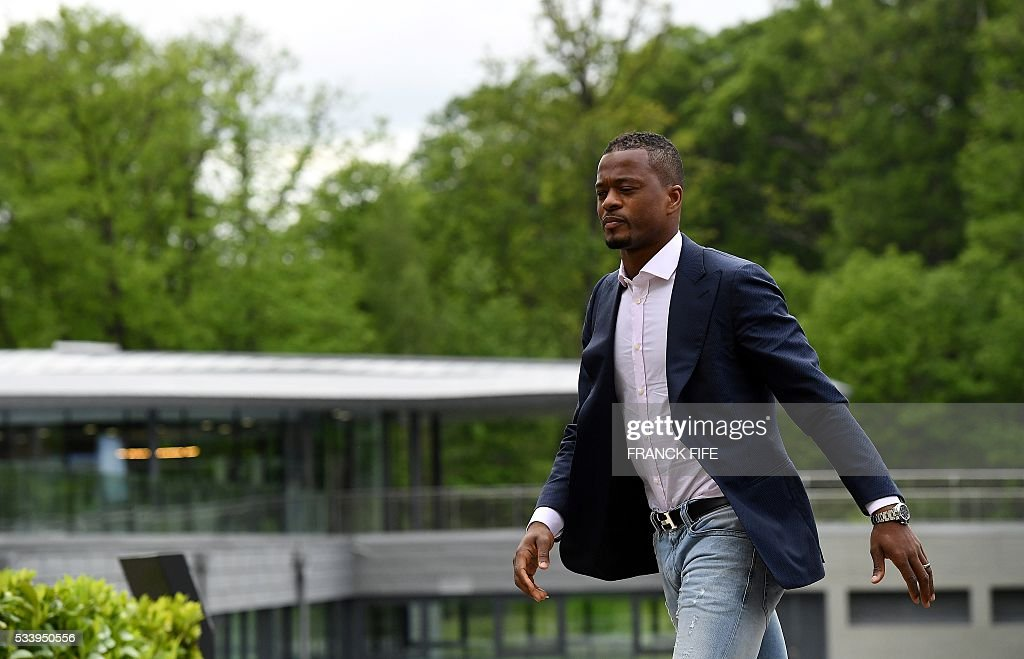 France's defender Patrice Evra arrives at the French national football team training base in Clairefontaine on May 24, 2016, as part of the team's preparation for the upcoming Euro 2016 European football championships. / AFP / FRANCK