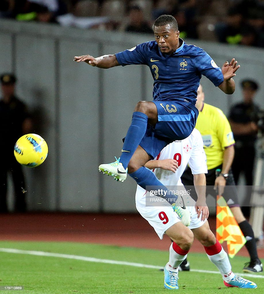 France's defender Patrice Evra (L) controls the ball in front Georgia's froward Nikolav Gelachvili during the FIFA World Cup 2014 qualifying football match Georgia vs France on September 6 2013 at the Boris Paichadze stadium in Tbilisi.