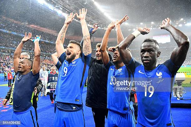 France's defender Patrice Evra forward Olivier Giroud forward Kingsley Coman and France's defender Bacary Sagna acknowledge the fans after France...
