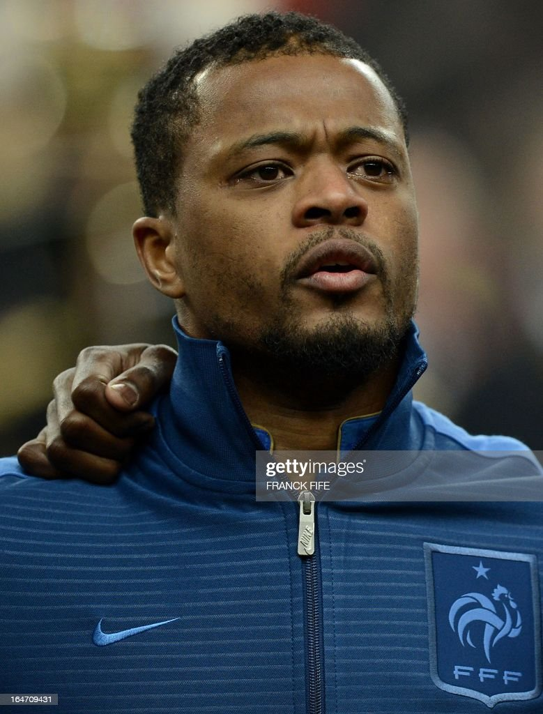France's defender Patrice Evra listens to the national anthems before a World Cup 2014 qualifying football match between France and Spain on March 26, 2013 at the Stade de France in Saint-Denis, outside Paris.