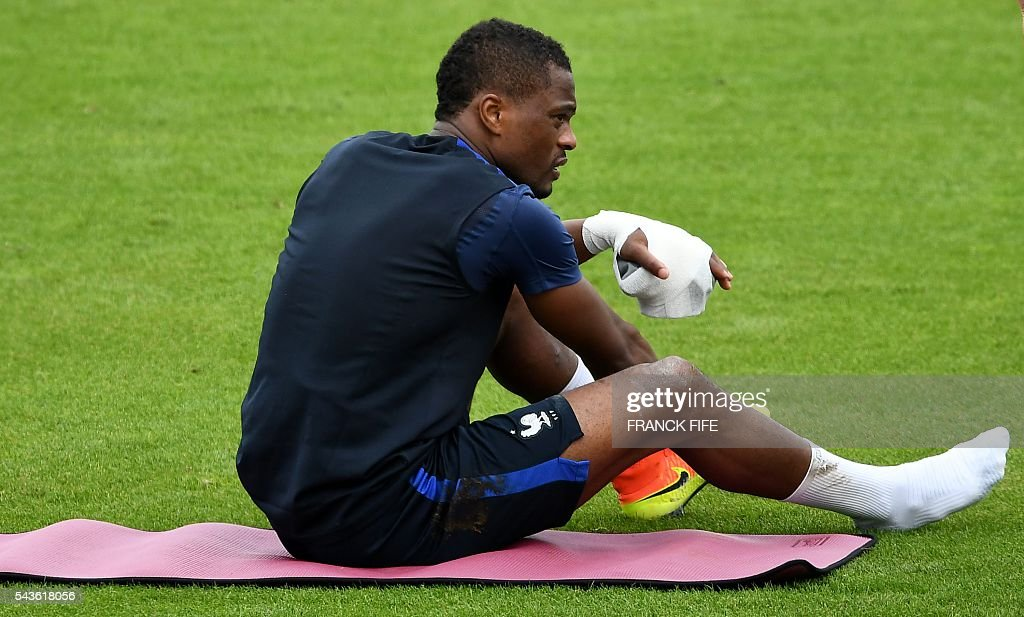 France's defender Patrice Evra reacts after being injured during a training session in Clairefontaine-en-Yvelines, southwest of Paris, on June 29, 2016, during the Euro 2016 football tournament. / AFP / FRANCK