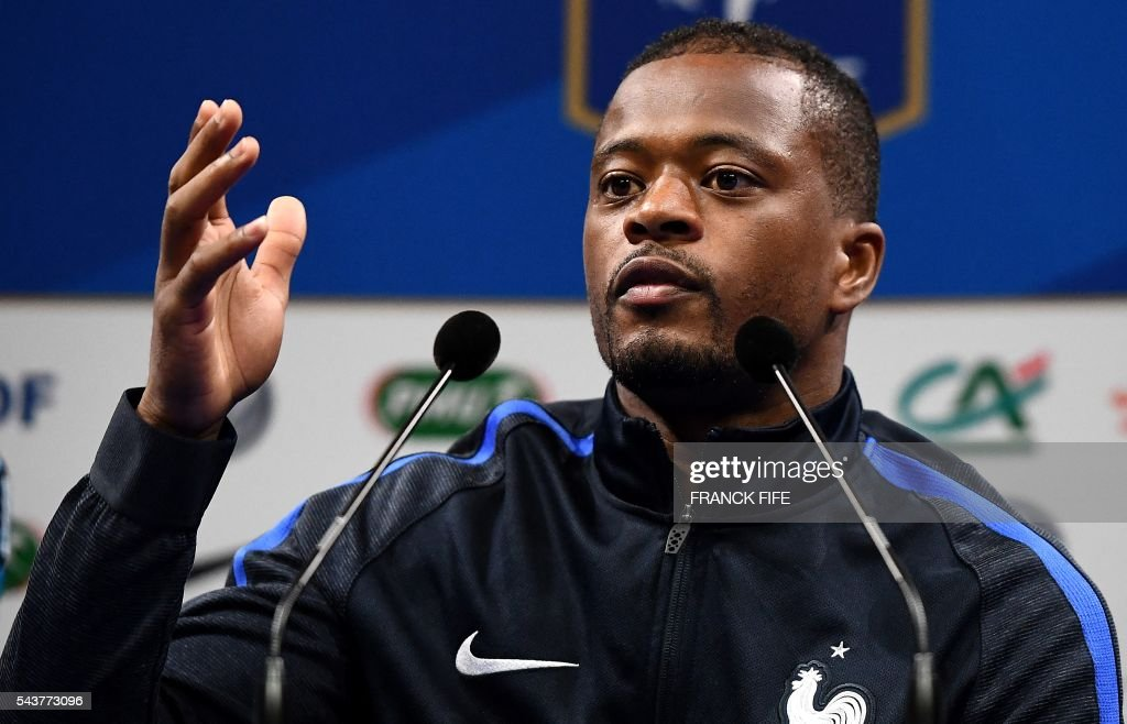 France's defender Patrice Evra reacts during a press conference in Clairefontaine en Yvelines on June 30, 2016, during the Euro 2016 football tournament. / AFP / FRANCK
