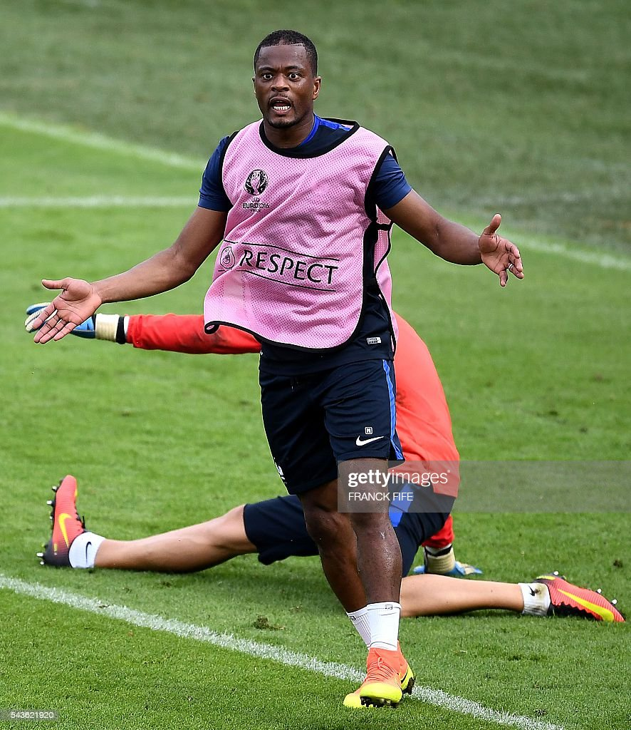 France's defender Patrice Evra reacts during a training session in Clairefontaine-en-Yvelines, southwest of Paris, on June 29, 2016, during the Euro 2016 football tournament. / AFP / FRANCK