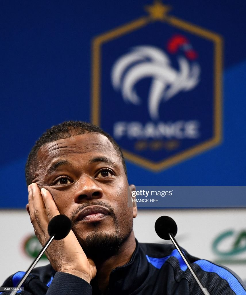 France's defender Patrice Evra smiles during a press conference in Clairefontaine en Yvelines on June 30, 2016, during the Euro 2016 football tournament. / AFP / FRANCK