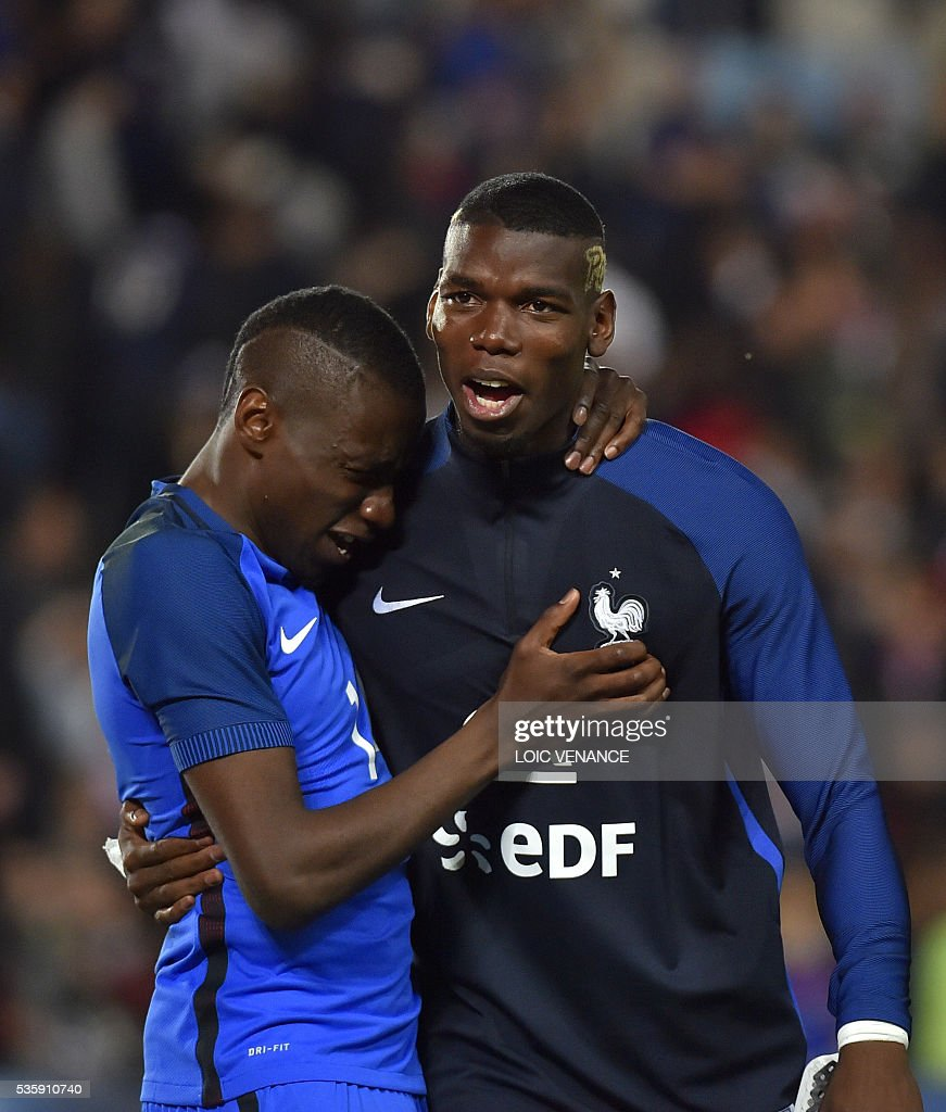 France's defender Paul Pogba (R) and France's midfielder Blaise Matuidi celebrate after winning the friendly football match between France and Cameroon, at the Beaujoire Stadium in Nantes, western France, on May 30, 2016. / AFP / LOIC