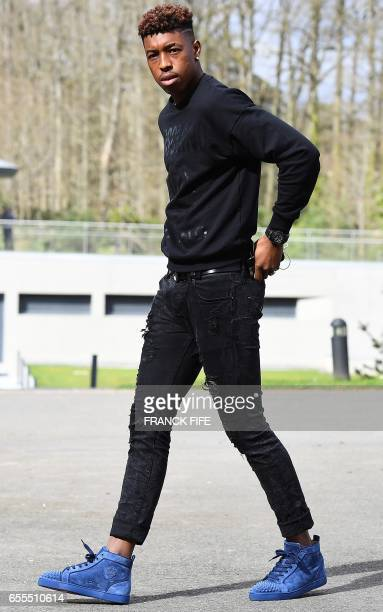 France's defender Presnel Kimpembe arrives at the French national football team training base in Clairefontaine near Paris on March 20 as part of the...