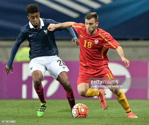 France's defender Presnel Kimpembe fights for the ball with Macedonia's forward Viktor Angelov during the UEFA Euro 2017 U21 Championship qualifying...
