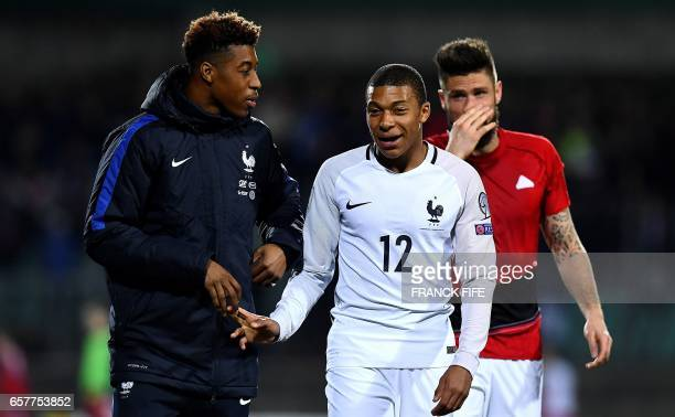 France's defender Presnel Kimpembe France's forward Kylian Mbappe and France's forward Olivier Giroud react at the end of the FIFA World Cup 2018...
