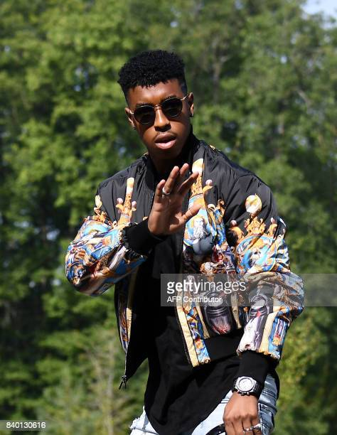 France's defender Presnel Kimpembe waves as he arrives at the French national football team training base in Clairefontaine on August 28 as part of...