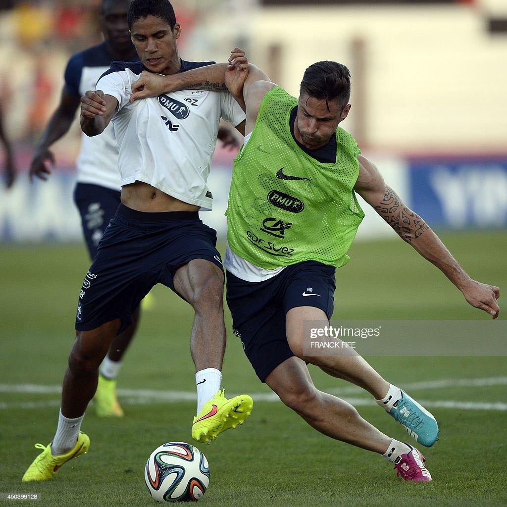 France s defender Raphael Varane L and France s forward Olivier