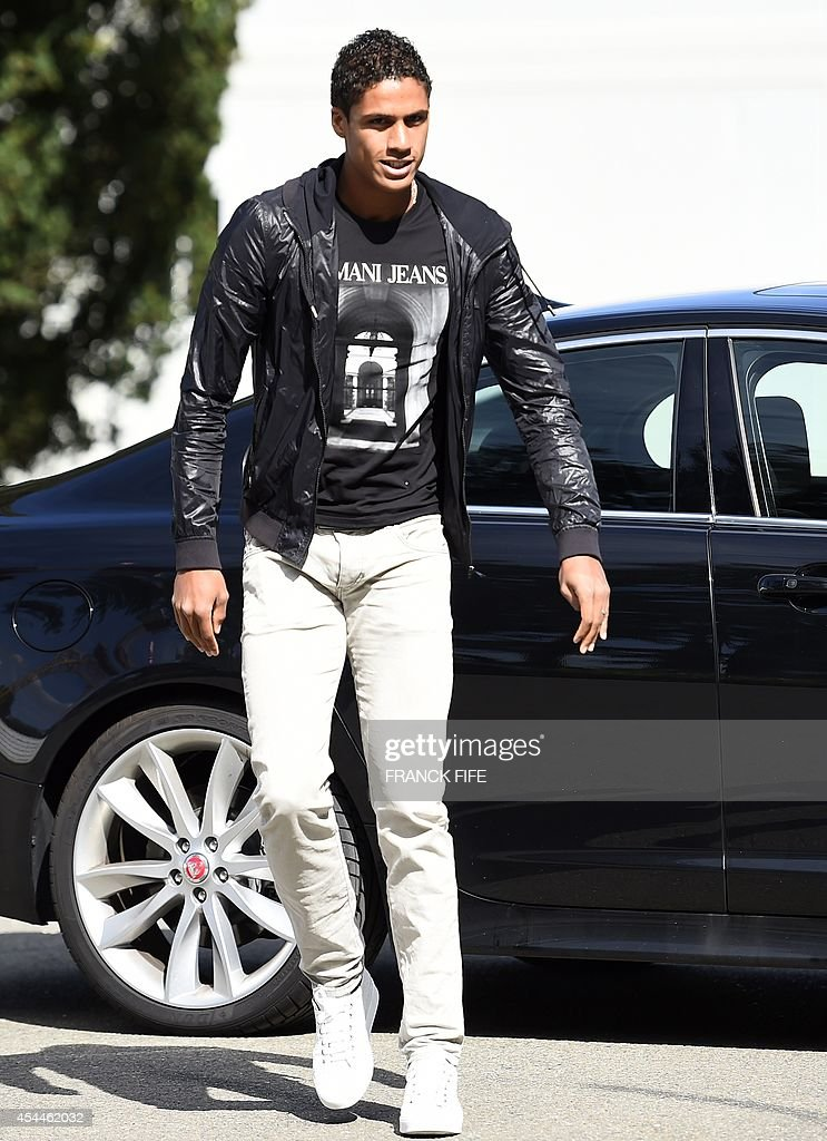 France's defender Raphael Varane arrives at the French national football team training base in Clairefontaine on September 1, 2014 on the first day of their training ahead of the friendly football match against Spain to be held on September 4. AFP PHOTO / FRANCK FIFE