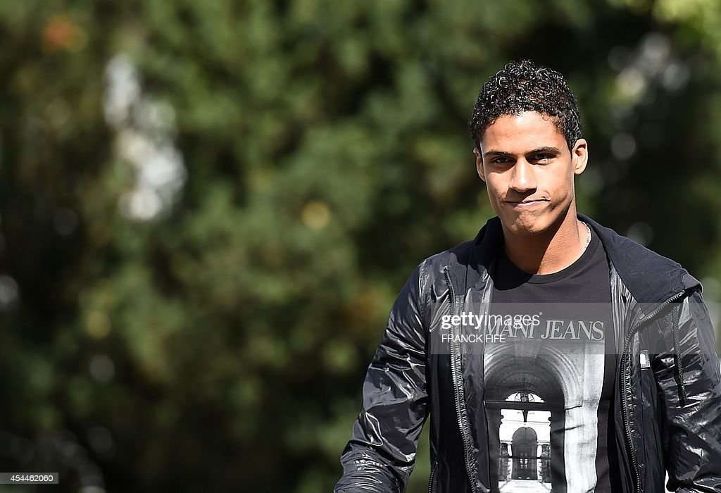 France's defender Raphael Varane arrives at the French national football team training base in Clairefontaine on September 1, 2014 on the first day of their training ahead of the friendly football match against Spain to be held on September 4.