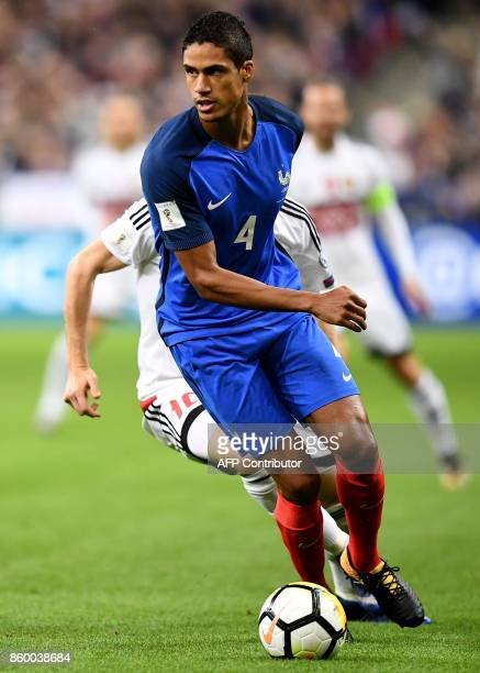 France's defender Raphael Varane controls the ball during the FIFA World Cup 2018 qualification football match between France and Belarus at the...