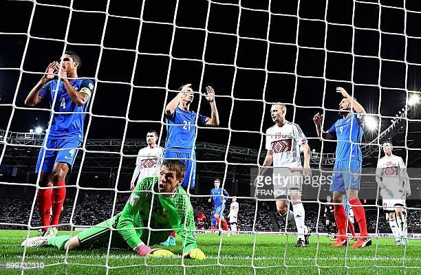 France's defender Raphael Varane France's defender Laurent Koscielny and France's forward Olivier Giroud react after missing a goal opportunity...