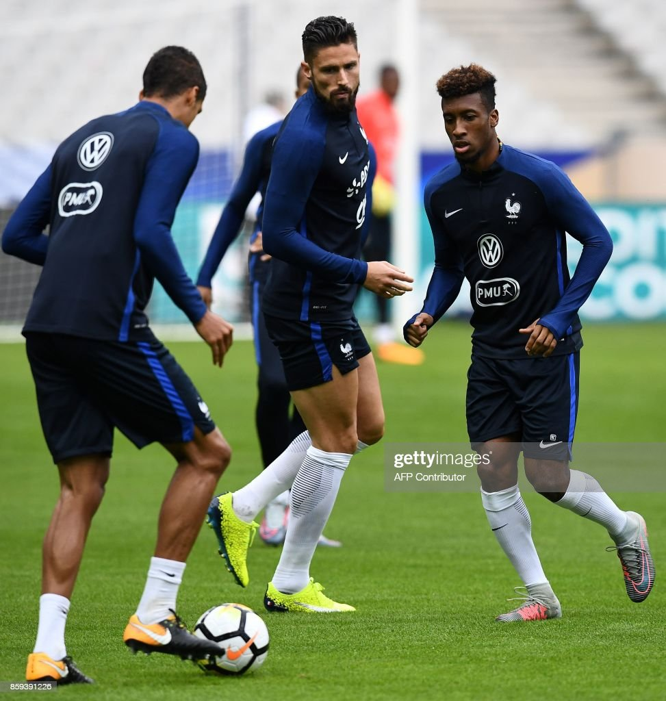 France s defender Raphael Varane France s forward Olivier Giroud