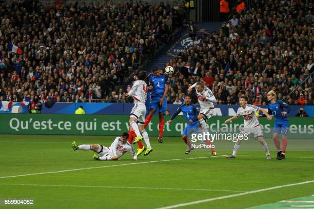 France's defender Raphael Varane heads the ball during the FIFA World Cup 2018 qualification football match between France and Belarus at the Stade...