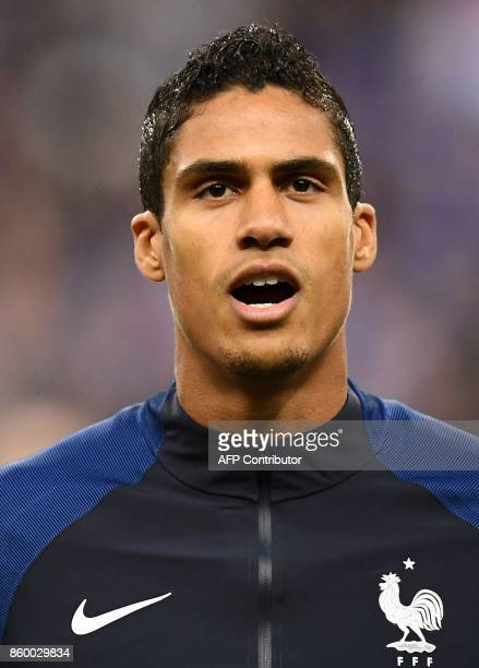 France's defender Raphael Varane poses ahead of the FIFA World Cup 2018 qualification football match between France and Belarus at the Stade de...