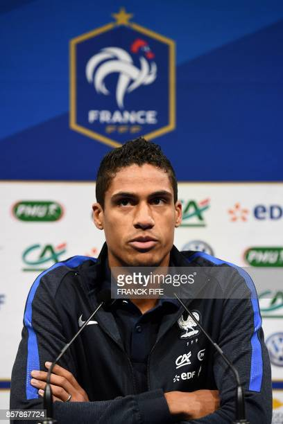 France's defender Raphael Varane speaks during a press conference in ClairefontaineenYvelines on October 5 as part of the team's preparation for the...