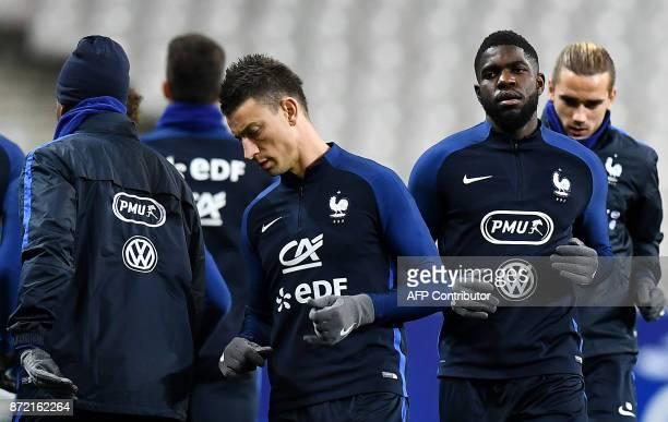 France's defender Samuel Umtiti and France's defender Laurent Koscielny take part in a training session at the Stade de France stadium in SaintDenis...