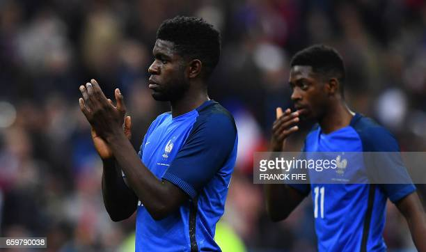 France's defender Samuel Umtiti and France's forward Ousmane Dembele react at the end of the friendly football match France vs Spain on March 28 2017...