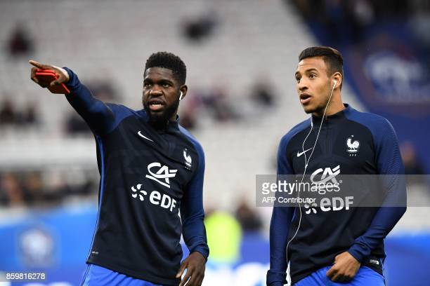 France's defender Samuel Umtiti and France's midfielder Corentin Tolisso stand on the pitch prior to the FIFA World Cup 2018 qualification football...