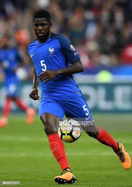 France's defender Samuel Umtiti controls the ball during the FIFA World Cup 2018 qualification football match between France and Belarus at the Stade...