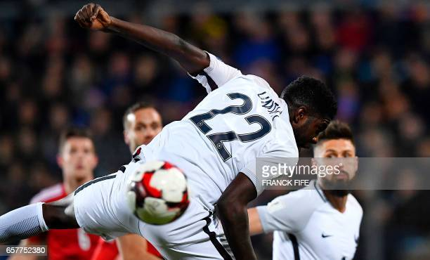 France's defender Samuel Umtiti heads the ball during the FIFA World Cup 2018 qualifying football match Luxembourg vs France on March 25 2017 at Josy...