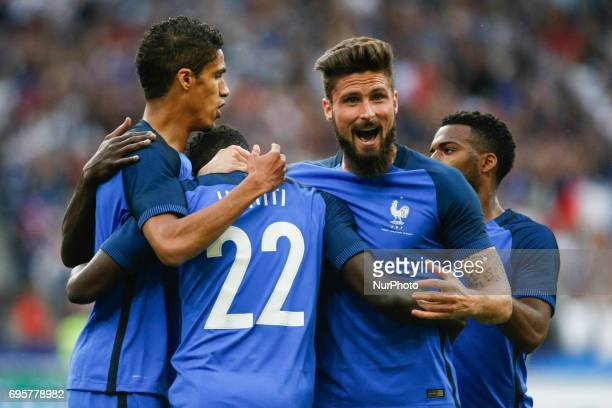 France's defender Samuel Umtiti is embraced by teammates after scoring during the international friendly football match between France and England at...