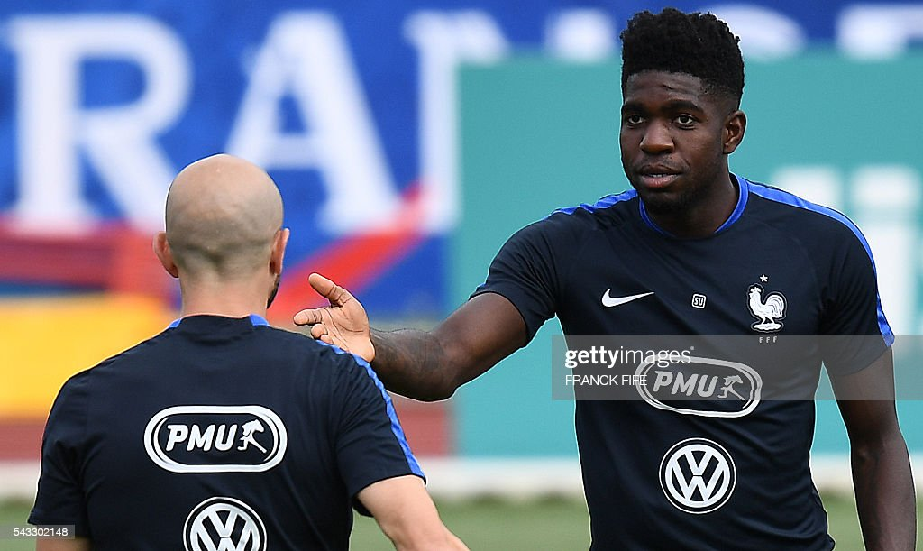 France's defender Samuel Umtiti (R) reacts next to France's defender Christophe Jallet during a training session in Clairefontaine-en-Yvelines, southwest of Paris, on June 6, 2016, during the Euro 2016 football tournament. / AFP / FRANCK