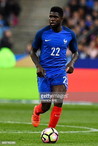 France's defender Samuel Umtiti runs with the ball during the friendly football match France vs Spain on March 28 2017 at the Stade de France stadium...