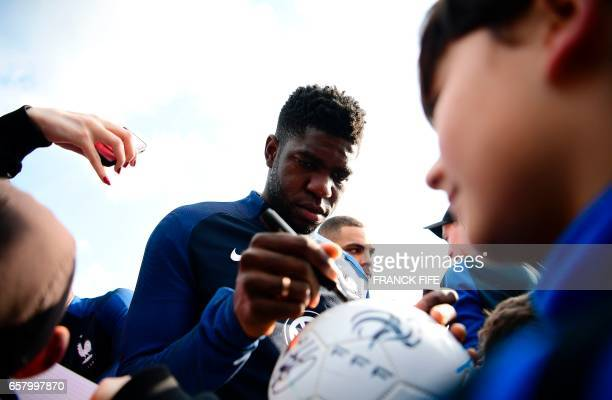 France's defender Samuel Umtiti signs autographs before a training session as part of the team's preparation for the upcoming friendly football match...
