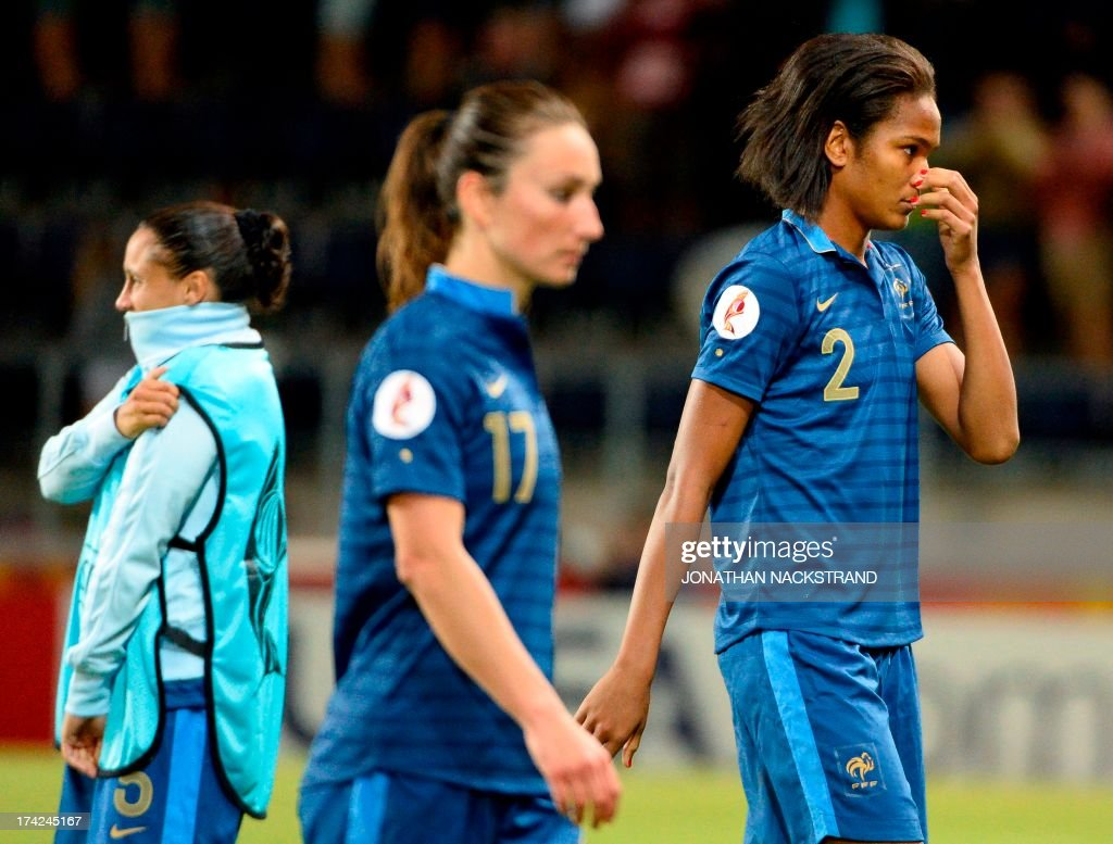 France's defender Wendie Renard (R) and midfielder Gaetane Thiney (C) react after losing in the penalty shootout of the UEFA Women's European Championship Euro 2013 quarter final football match France vs Denmark on July 22, 2013 in Linkoping, Sweden. AFP PHOTO/JONATHAN NACKSTRAND